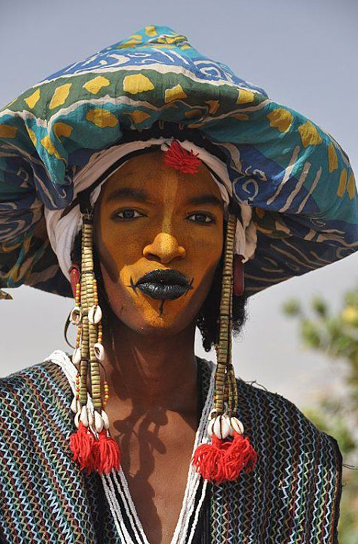 Africa Wodaabe man participating in the Yaake dance