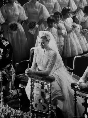 Grace Kelly praying during her Catholic wedding ceremony to Prince Rainier of Mo