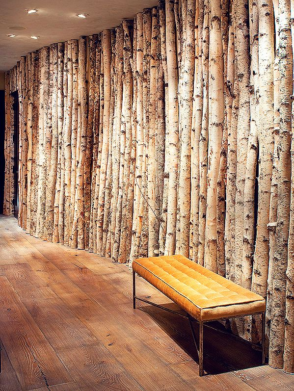 Birch trees lining this hallway were adhered to the plywood wall, covered in a light coat of plaster, with hidden screws. The team