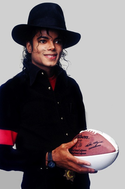 Michael Jackson holding a football