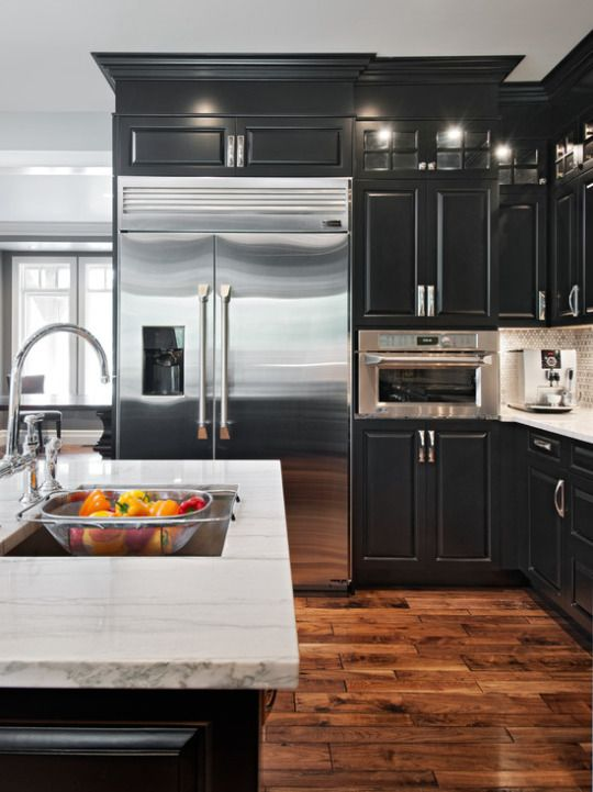 Black Cabinets With White Granite Counters And Distressed Hardwood Floors Stainless Appliances