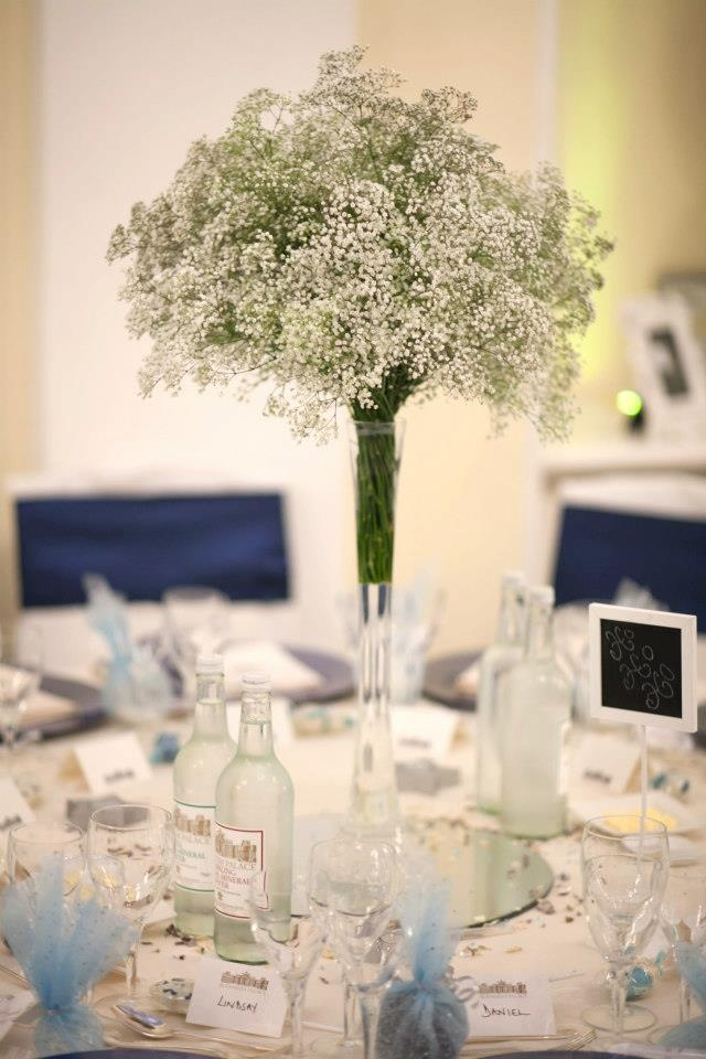 Tall Slim Lily Vases Filled With Gypsophila On The Tables