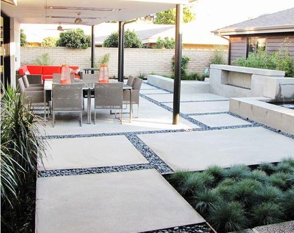 Large concrete slab and pebble patio design