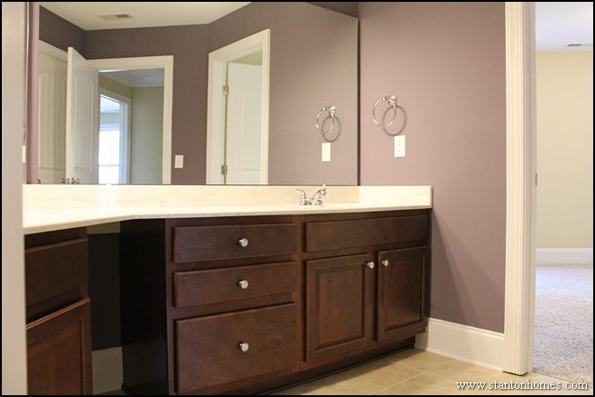 Dark Brown Cabinets In A Purple Bathroom