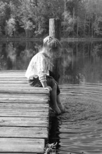 daydreaming child on the waterside