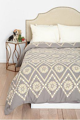 Check out Urban Outfitters bedding selection.  Home accessories are a necessity for your new