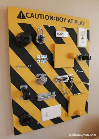 DIY busy board full of switches, latches, and doo-dads for babies and toddlers to manipulate.: