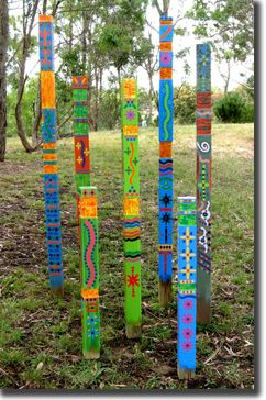 Garden totems. I would bet these would be easy to make…some 2 x 4's, paint, stamps, etc. and stick in the ground.