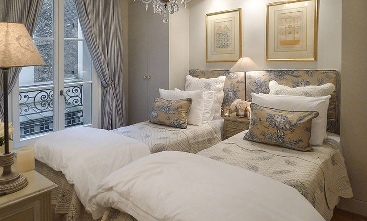 Love this shared headboard with two twin beds could scoot