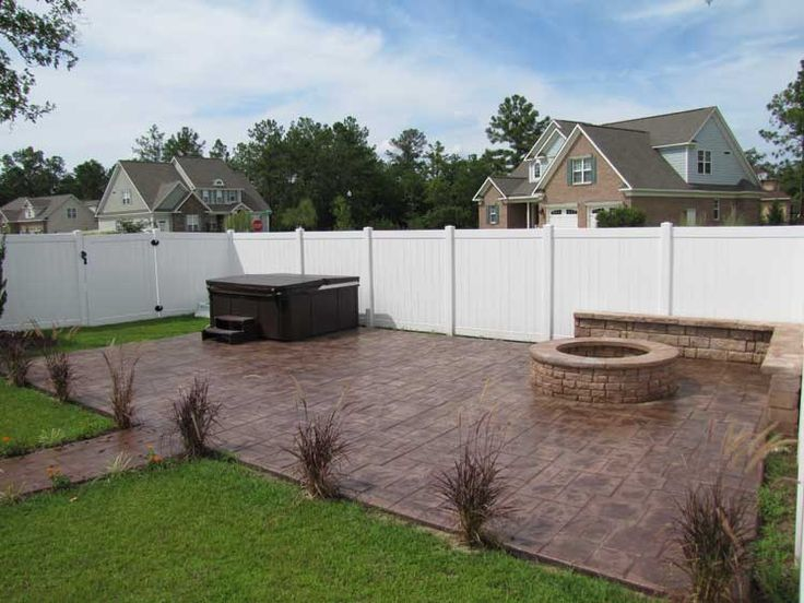 Hot Tub On Stamped Concrete With Fire Pit And Seat Wall By