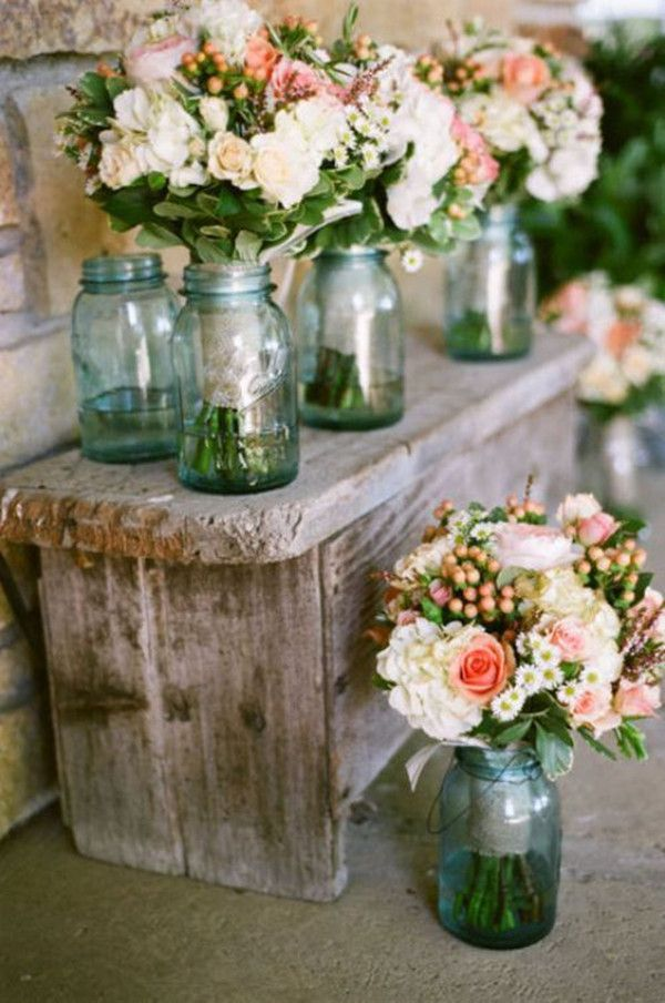 rustic wedding decoration ideas with flowers and mason jars… have to ask Jennifer what she thinks about these