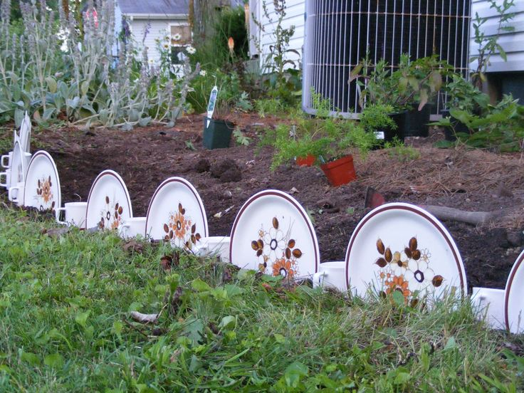 Creative flower bed border...coffee cups and dinner plates