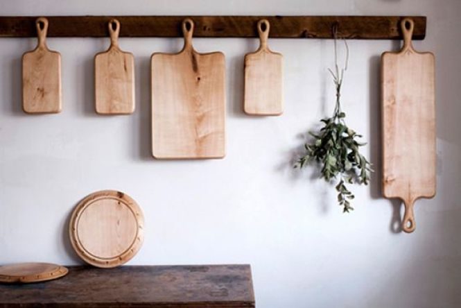 Hang cutting boards for a cute display and some extra cabinet space // Storage Solutions
