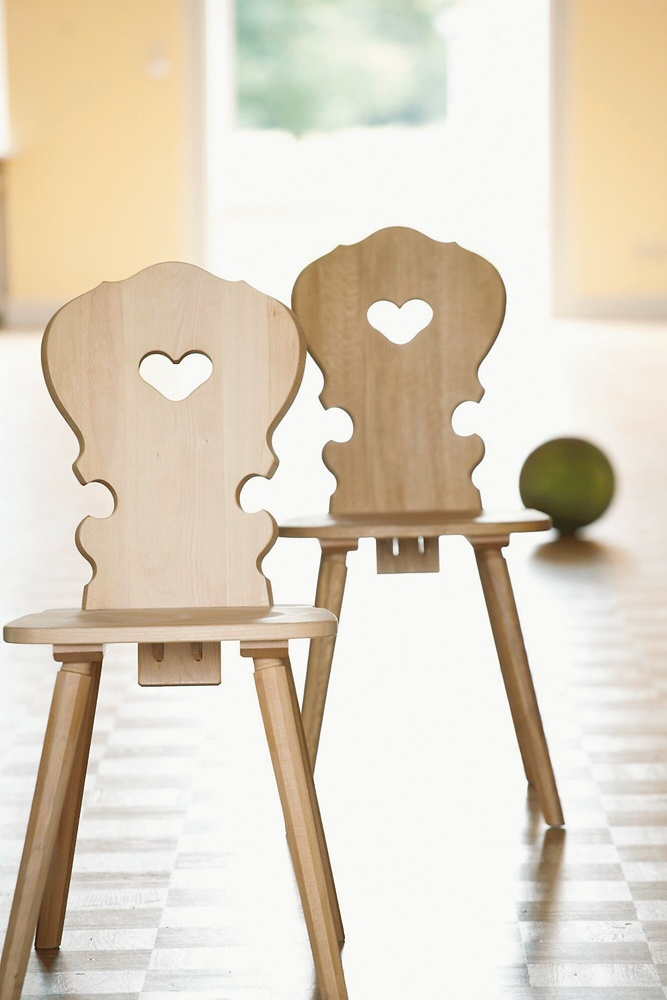 Wood chairs with heart cutouts south Tirol. .nehmen