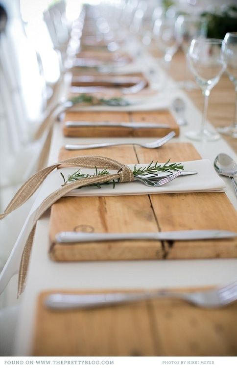 Rustic table setting with wooden slabs, rosemary and burlap ribbon via The Pretty Blog.  Photography by Nikki Meyer.