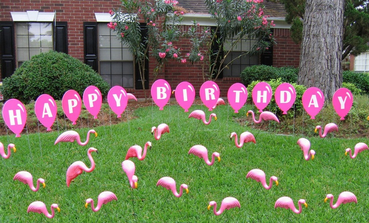 A flock of pink flamingos with pink happy birthday