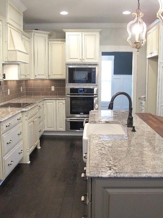 white glazed cabinets, minka lighting, bianco antico granite, subway tile backsplash, gray kitchen island, kohler farm house sink,