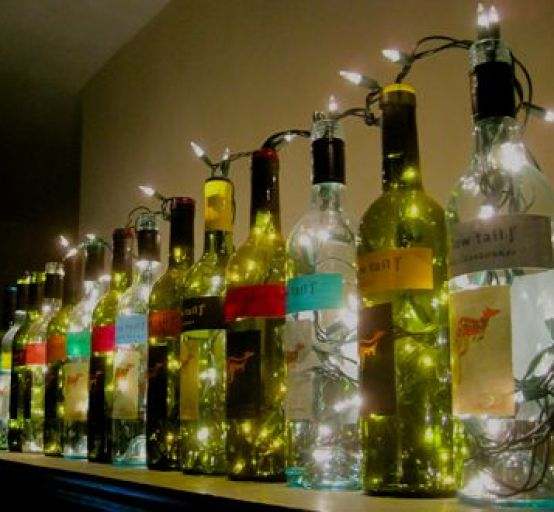 wine bottle lights. these are perfect for lining the top of the bar, instead of boring empty bottles: