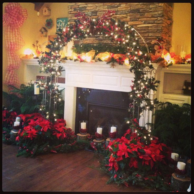 Christmas fireplace wedding arch poinsettias indoor