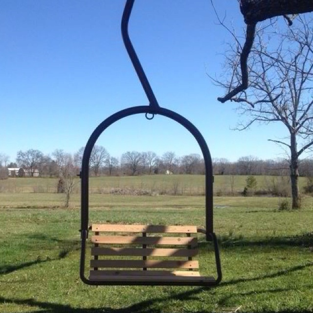 An old ski lift chair redone into a tree swing.. Made by