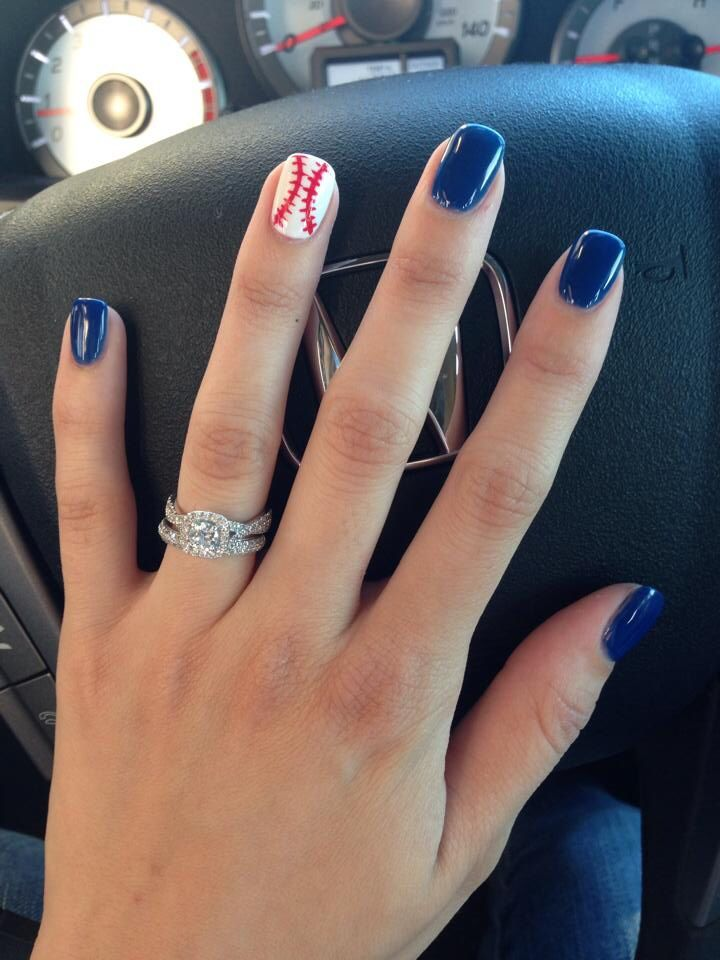 Im not crazy about blue nails but thats our color…this is what itd look like except Id angle the baseball stitching.