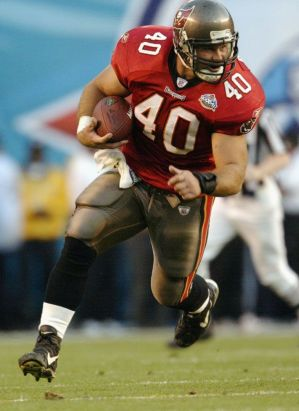Mike Alstott runs with the ball.