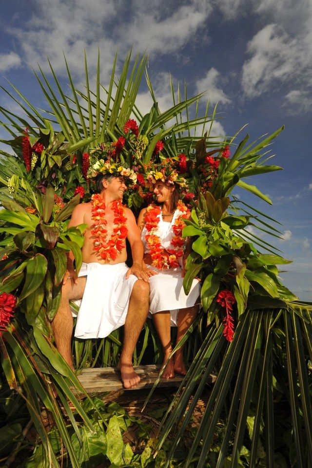 A young couple having a destination wedding in Tahiti.
