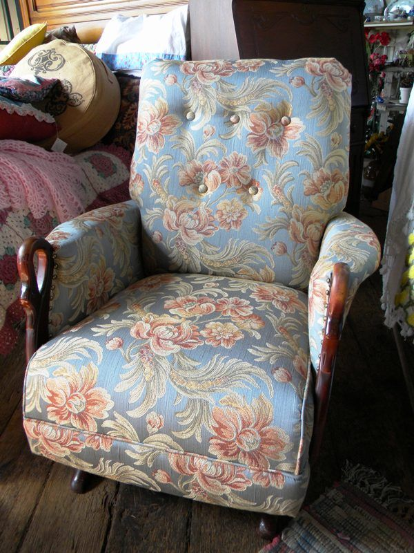 Antique rocking chair with swan arms. Newly refurbished