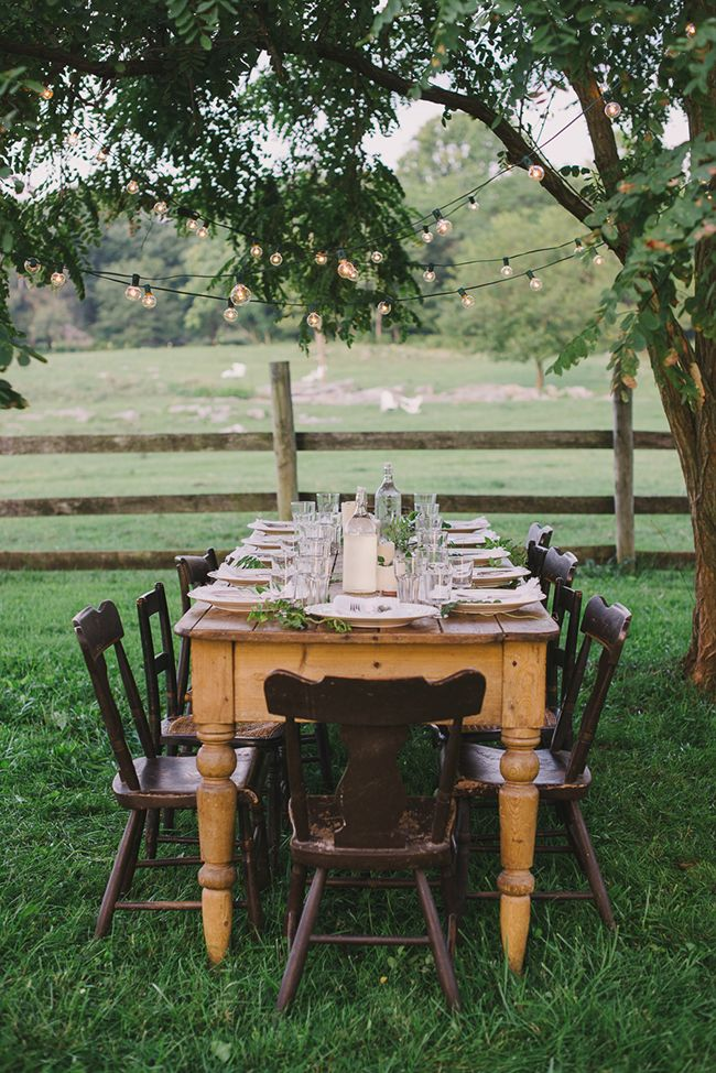 Farmhouse table set up for outdoor dinner party...unique