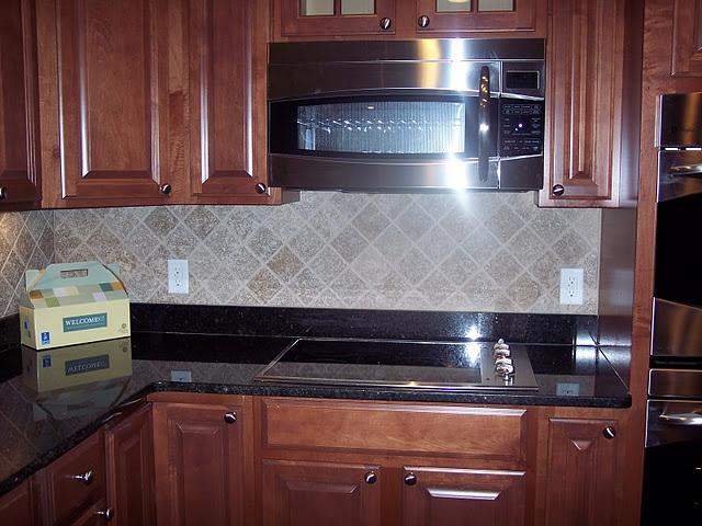 Cabinets Maple With A Cognac Glaze Granite Is Ubatuba