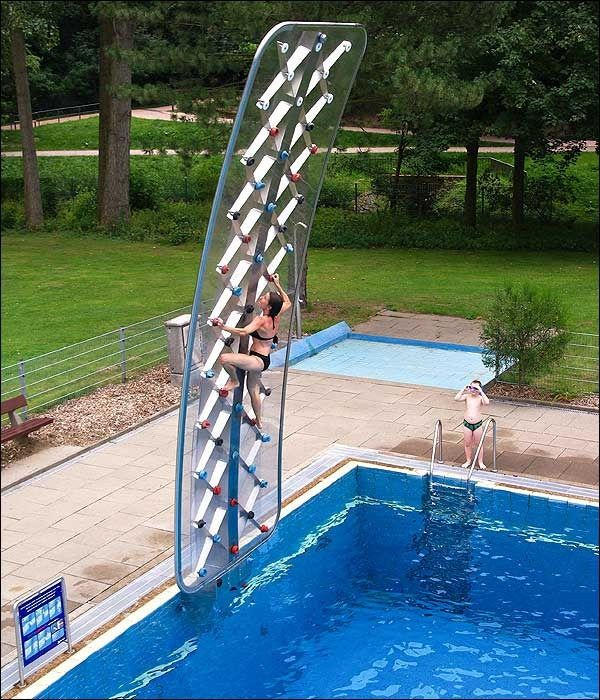 Poolside ROCK CLIMBING WALL?!?!  When I win the lottery, this is a must have!