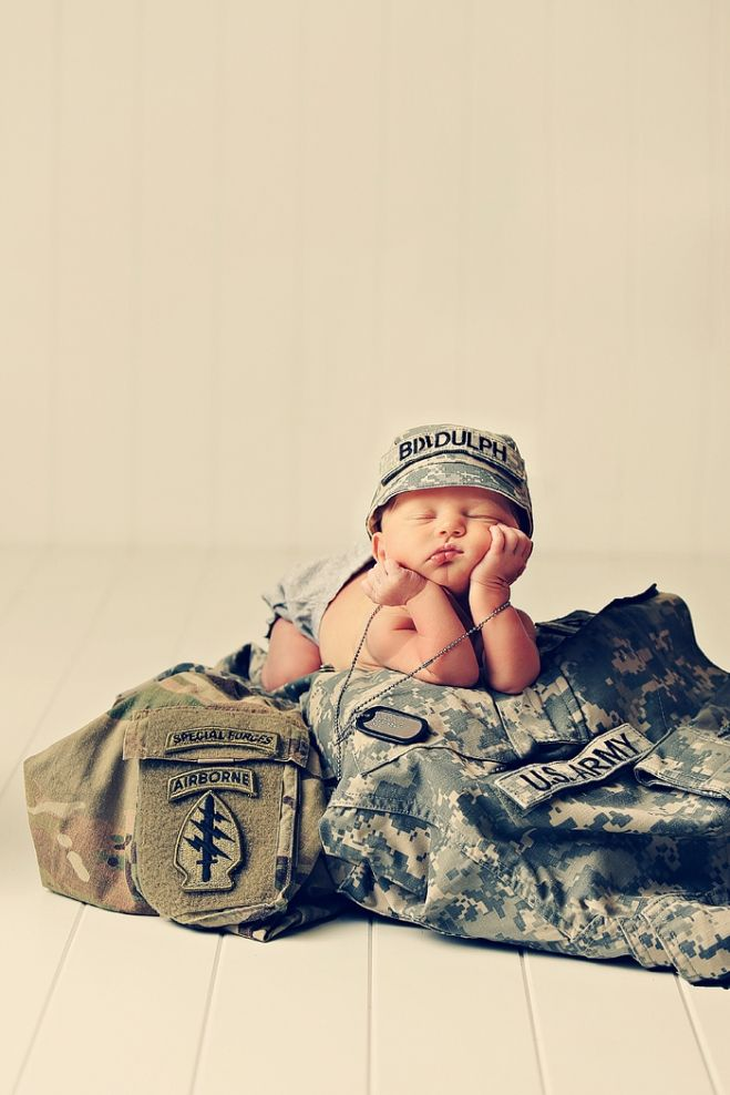 Military Newborn Photography….maybe something similar with my husband's police uniform?