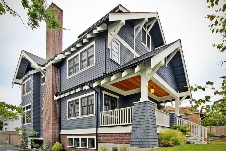 All American Blue Craftsman Home With Black Windows And