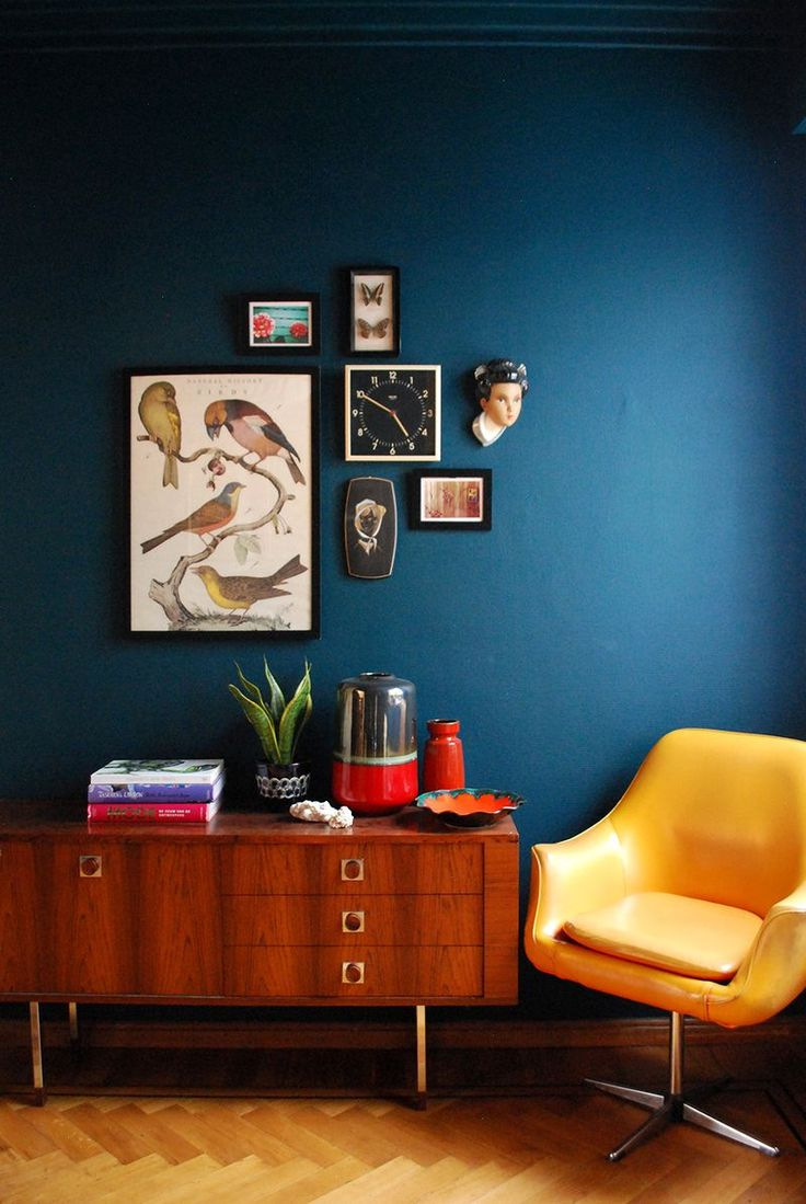 At Home With Patricia Goijens – Love the combination of dark blue and yellow chair