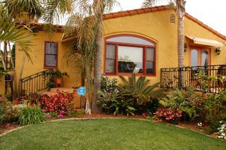 Bright Colorful Happy Little Stucco House Exterior