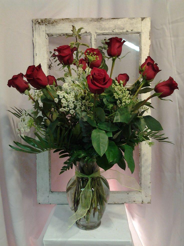 Our standard One Dozen Long Stem Rose arrangement