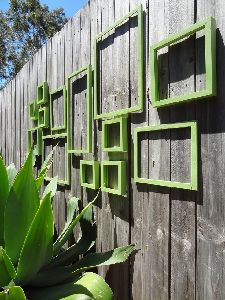 This is what I want to do but with round and oval ones!!! Fence wall art.