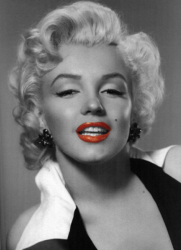 Marilyn Monroe in black and white with a splash of red