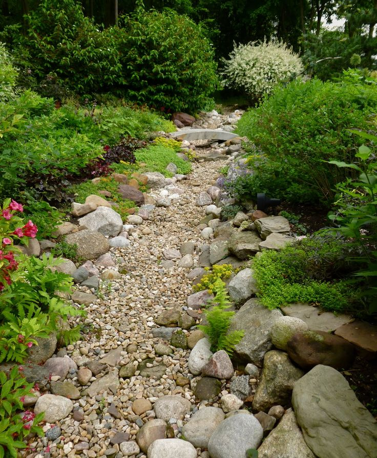 Dry riverbed Drought tolerant landscaping Pinterest