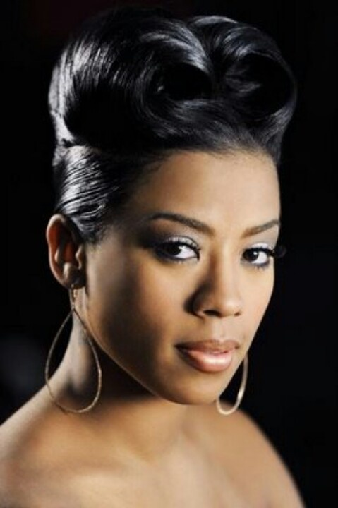 Keyshia Cole With A French Roll Hairstyle African