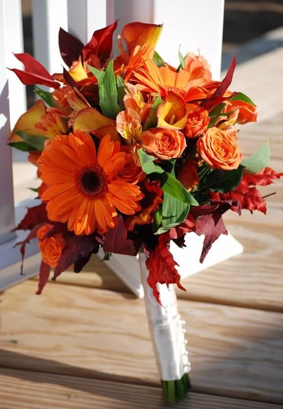 Fall bridal hand bouquet. Orange gerbera, mango spray