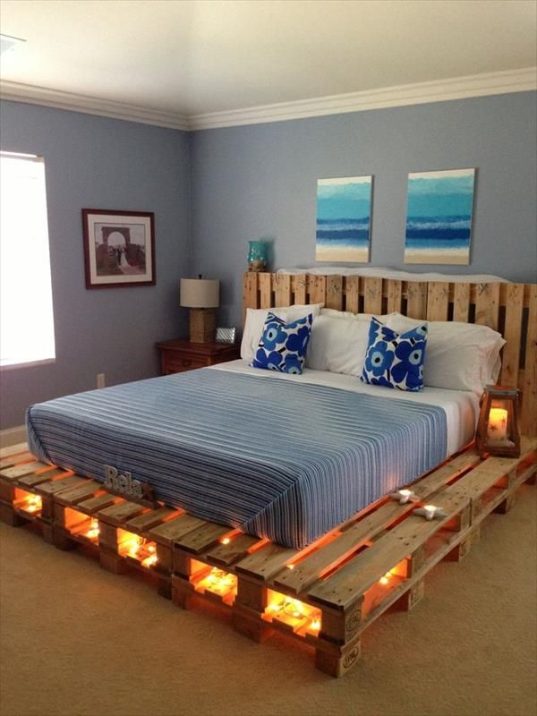 15 Unique DIY Wooden Pallet Bed Ideas | DIY and Crafts I like this diy bed made with pallets and string lights in the cubbie holes
