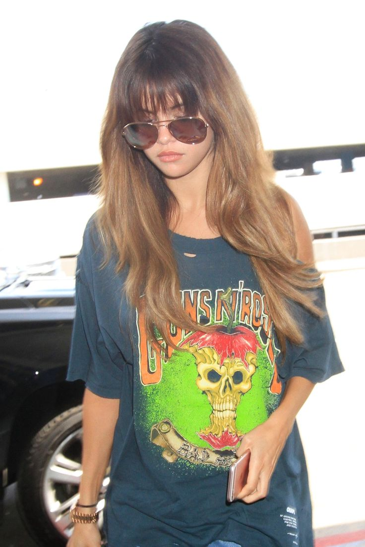 Selena Gomez Rules LAX Airport With This Waist Grazing