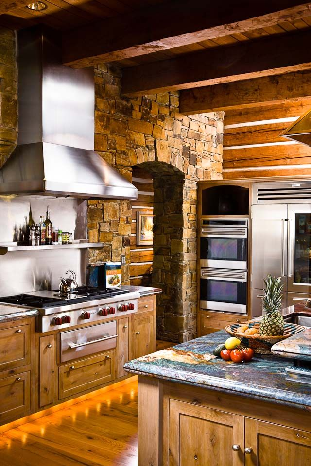 Stone entry, industrial range, double oven, everything a