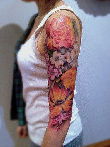 half sleeve watercolor tattoo of different flowers – upper arm, peony
