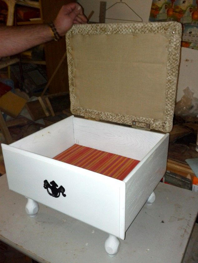 And legs to an old drawer, hinged lid with a padded top, and you have an ottoman