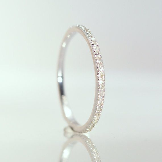 Eternity diamond wedding band 14k white gold, 2/3 eternity total 0.3 carat diamonds. $340.00, via Etsy.