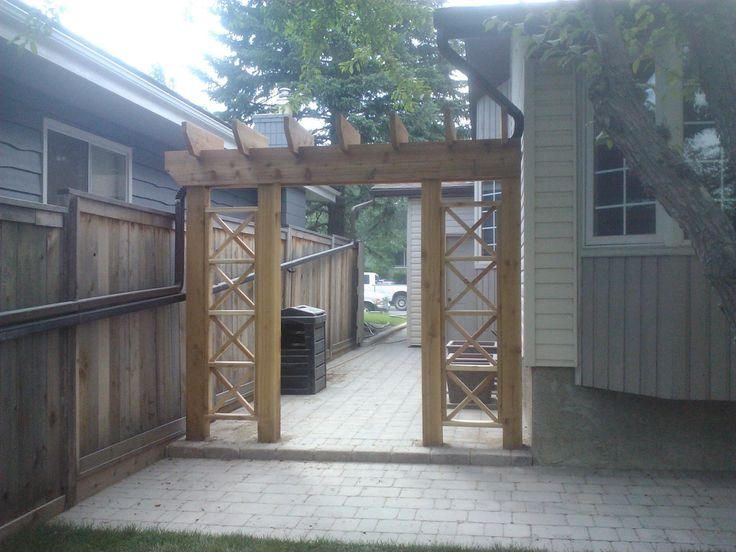 Cedar Arbor To Hide Redirected Downspout Sub In A Pretty
