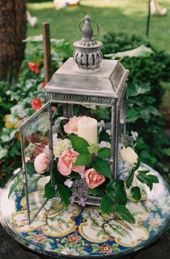 flower and candle lantern. Beautiful bridal shower or wedding decor.