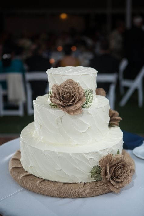 Three tiered white wedding cake with burlap flowers // Cake: A Spoon Fulla Sugar // Shelby Street Photography //